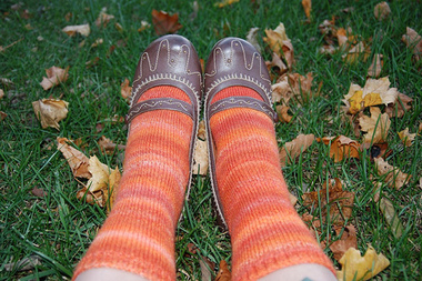 Shoed_feet_fallen_leaves